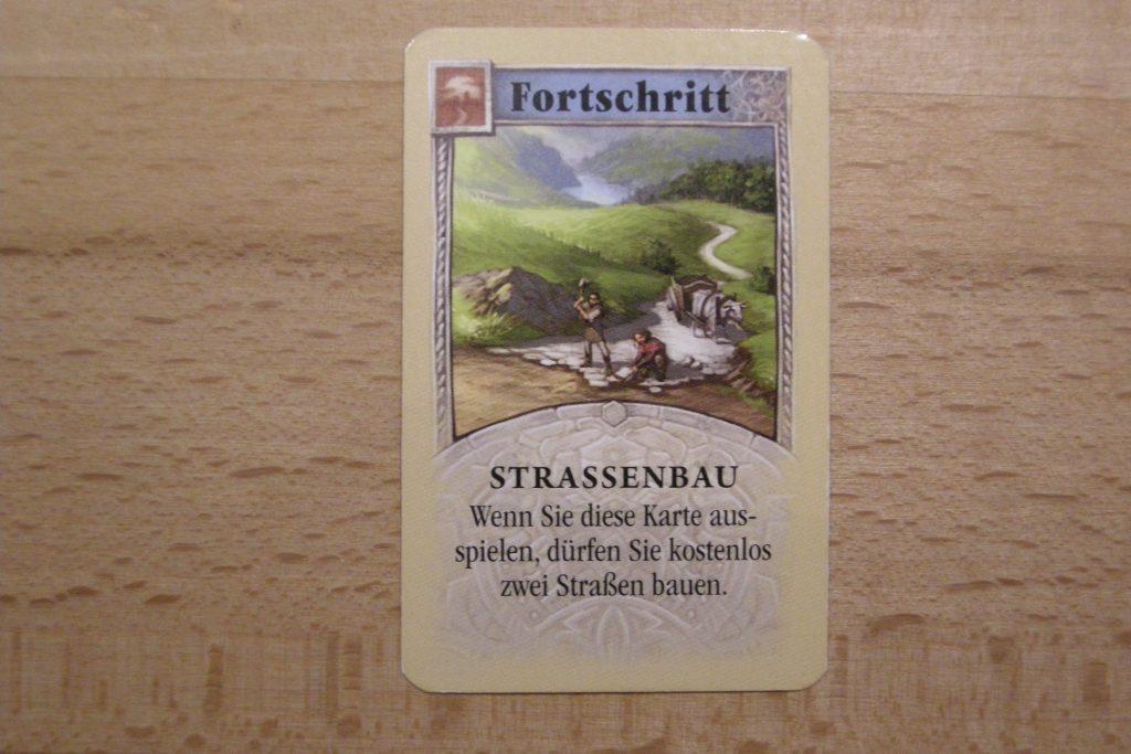 Catan - Fortschrittskarte Strassenbau